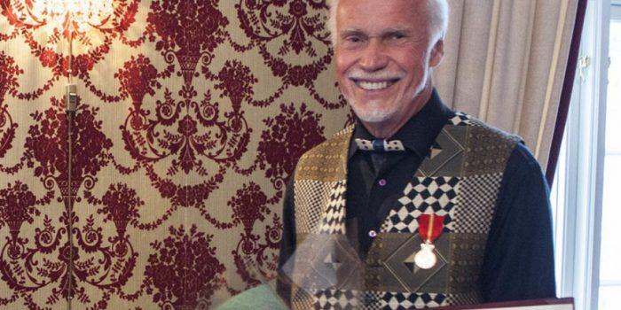 Kongens fortjenstmedalje til Rolf S. Grundesen